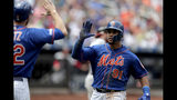 New York Mets' Carlos Gomez, right, is greeted by Steven Matz after scoring on a sacrifice fly by Juan Lagares during the fifth inning of a baseball game against the Washington Nationals, Thursday, May 23, 2019, in New York. (AP Photo/Julio Cortez)