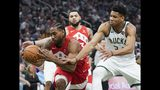 Milwaukee Bucks' Giannis Antetokounmpo and Toronto Raptors' Kawhi Leonard go after a loose ball during the first half of Game 5 of the NBA Eastern Conference basketball playoff finals Thursday, May 23, 2019, in Milwaukee. (AP Photo/Morry Gash)