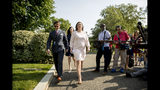From left, Deputy White House press secretary Hogan Gidley, White House director of broadcast media Alexa Henning, and White House press secretary Sarah Huckabee Sanders leave an interview along Pebble Beach on the North Lawn outside the West Wing at the White House in Washington, Thursday, May 23, 2019.(AP Photo/Andrew Harnik)