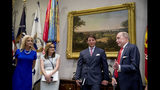 White House chief economic adviser Larry Kudlow, right, accompanied by from left, counselor to the President Kellyanne Conway, Mercedes Schlapp, Director of strategic communications, and Deputy White House press secretary Hogan Gidley speaks after President Donald Trump asks him how his demeanor was during yesterday's infrastructure meeting with House Speaker Nancy Pelosi of Calif. and other Democratic leaders during a meeting to support America's farmers and ranchers in the Roosevelt Room of the White House, Thursday, May 23, 2019, in Washington. (AP Photo/Andrew Harnik)