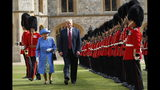 FILE - In this July 13, 2018 file photo, U.S. President Donald Trump with Queen Elizabeth II, inspects the Guard of Honour at Windsor Castle in Windsor, England. Trump's next few weeks will serve as a master's class in the finer points _ and potential pitfalls _ of protocol. He's making state visits to Japan and the United Kingdom where he'll be meeting with both Britain's Queen Elizabeth II and Japan's newly installed Emperor Naruhito. (AP Photo/Pablo Martinez Monsivais)