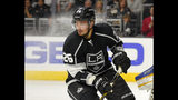 FILE - In this Oct. 16, 2014, file photo, Los Angeles Kings defenseman Slava Voynov, of Russia, skates during the third period of an NHL hockey game against the St. Louis Blues in Los Angeles. An arbitrator has upheld Voynov's one-season suspension by the NHL but is giving him credit for serving half of it in 2018-19. Commissioner Gary Bettman suspended the former Los Angeles Kings defenseman for the 2019-20 season and 2020 playoffs after it determined he committed acts of domestic violence. The NHL Players Association appealed the ruling. (AP Photo/Mark J. Terrill, File)