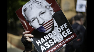 The Latest: Assange lawyer says charges threaten journalists