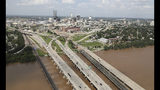 This aerial image shows the Arkansas River with the Tulsa, Okla., skyline after flooding on Thursday, May 23, 2019. Storms and torrential rains have ravaged the Midwest, from Texas through Oklahoma, Kansas, Nebraska, Iowa, Missouri and Illinois, in the past few days. (Tom Gilbert/Tulsa World via AP)