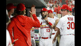 St. Louis Cardinals' Matt Carpenter (13) is congratulated by teammates after hitting a solo home run during the ninth inning of a baseball game against the Atlanta Braves, Friday, May 24, 2019, in St. Louis. (AP Photo/Scott Kane)