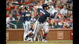 Atlanta Braves' Dansby Swanson follows through on a two-run home run during the eighth inning of a baseball game against the St. Louis Cardinals, Friday, May 24, 2019, in St. Louis. (AP Photo/Scott Kane)