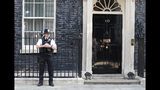 A police officer stands outside 10 Downing Street, the residence of British Prime Minister Theresa May, in London, England, Friday, May 24, 2019. Conservative lawmakers have given May until Friday to announce a departure date or face a likely leadership challenge. (AP Photo/Alastair Grant)