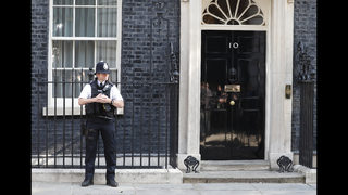 The Latest: PM May resigns, won