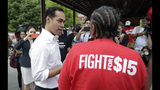 """In this May 23, 2019, photo, Democratic presidential candidate and former U.S. Department of Housing and Urban Development Julian Castro speaks with a supporter before rallying with McDonald's employees and other activists in Durham, N.C. Hispanics are poised to help shape the 2020 Democratic primary in unprecedented ways. They comprise almost 30% of the population in the state that votes third in presidential primaries, Nevada. And the nation's two largest Latino states, California and Texas, are among the 14 """"Super Tuesday"""" states voting 10 just days later. (AP Photo/Gerry Broome)"""