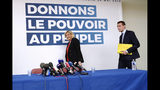 French far-right leader Marine Le Pen, left, followed by top of the list Jordan Bardella arrive at a press conference in Henin-Beaumont, northern France, Friday, May. 24, 2019. Polls suggest that Le Pen's party will be among France's top two vote-getters in the election, along with French President Emmanuel Macron's party. (AP Photo/Michel Spingler)