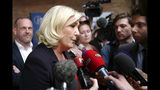 French far-right leader Marine Le Pen answers reporters after a press conference in Henin-Beaumont, northern France, Friday, May. 24, 2019. Polls suggest that Le Pen's party will be among France's top two vote-getters in the election, along with French President Emmanuel Macron's party. (AP Photo/Michel Spingler)