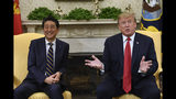 FILE - In this April 26, 2019, file photo, U.S. President Donald Trump, right, speaks while meeting with Japanese Prime Minister Shinzo Abe, left, in the Oval Office of the White House in Washington. Trump's Japan visit starting on Saturday, May 25, 2019, is to focus on personal ties with Abe rather than substantive results on trade, security or North Korea. (AP Photo/Susan Walsh, File)