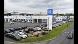This Sept. 2, 2018, photo shows new cars for sale at a Honda dealership in Union, NJ. When U.S. President Donald Trump visits Japan, he'll be able to point to Tokyo's streets to drive home a sore point in trade relations between the allies: the absence of made-in-USA vehicles. While Trump complained repeatedly about the trade imbalance, especially in autos and auto parts - the Hondas and Toyotas on U.S. roads are a daily reminder. (AP Photo/Ted Shaffrey)
