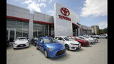 FILE - This Tuesday, June 13, 2017, file photo shows the Mark Miller Toyota dealership in Salt Lake City. When U.S. President Donald Trump visits Japan, he'll be able to point to Tokyo's streets to drive home a sore point in trade relations between the allies: the absence of made-in-USA vehicles. While Trump complained repeatedly about the trade imbalance, especially in autos and auto parts - the Hondas and Toyotas on U.S. roads are a daily reminder. (AP Photo/Rick Bowmer, File)
