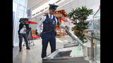 A Japanese police checks garbage boxes at a terminal of Haneda airport in Tokyo Thursday, May 23, 2019, ahead of planned visit by U.S. President Donald Trump. Trump is scheduled to visit Japan from May 25 until May 28. (Mizuki Ikari/Kyodo News via AP)