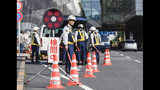 Japanese police check passersby near Haneda airport in Tokyo Thursday, May 23, 2019, ahead of planned visit by U.S. President Donald Trump. Trump is scheduled to visit Japan from May 25 until May 28. (Mizuki Ikari/Kyodo News via AP)