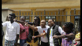 Kenya LGBT activists and their supporters gather outside the Milimani Court in Nairobi, Kenya Friday, May 24, 2019. Kenya's High Court is due to rule Friday on whether laws that criminalise same sex relations are unconstitutional (AP Photo/Khalil Senosi)