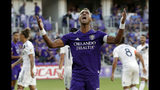 Orlando City's Nani reacts after missing a goal shot against the LA Galaxy during the first half of an MLS soccer match Friday, May 24, 2019, in Orlando, Fla. (AP Photo/John Raoux)