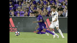 LA Galaxy's Joe Corona (14) trips up Orlando City's Ruan (2) while going for the ball during the second half of an MLS soccer match Friday, May 24, 2019, in Orlando, Fla. (AP Photo/John Raoux)