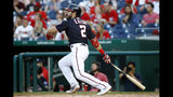 Washington Nationals' Adam Eaton watches his solo home run in the first inning of a baseball game against the Miami Marlins, Friday, May 24, 2019, in Washington. (AP Photo/Patrick Semansky)