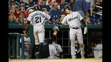 Miami Marlins' Brian Anderson, right, greets teammate Curtis Granderson after Granderson hit a solo home run in the fourth inning of a baseball game against the Washington Nationals, Friday, May 24, 2019, in Washington. (AP Photo/Patrick Semansky)