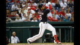 Washington Nationals' Anthony Rendon watches his two-run home run in the third inning of a baseball game against the Miami Marlins, Friday, May 24, 2019, in Washington. (AP Photo/Patrick Semansky)