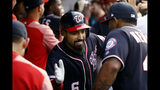 Washington Nationals' Anthony Rendon, center, celebrates his two-run home run with teammate Howie Kendrick, right, in the fourth inning of a baseball game against the Miami Marlins, Friday, May 24, 2019, in Washington. (AP Photo/Patrick Semansky)