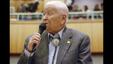 "FILE - In this Feb. 2, 2018, fle photo Democratic New Mexico state Sen. John Pinto talks about his career as a lawmaker on American Indian Day in the Legislature on in Santa Fe, N.M. Pinto joined the Senate in 1977 and is 92 years old. He was a Marine who trained as a Navajo code talker during World War II. His singing of the ""Potato Song"" is an annual Senate ritual. (AP Photo/Morgan Lee, File)"