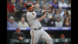 Baltimore Orioles' Trey Mancini follows through with his swing after connecting for a double against the Colorado Rockies in the first inning of a baseball game Friday, May 24, 2019, in Denver. (AP Photo/David Zalubowski)