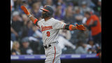 Baltimore Orioles' Keon Broxton celebrates his two-run home run off Colorado Rockies starting pitcher Jeff Hoffman in the second inning of a baseball game Friday, May 24, 2019, in Denver. (AP Photo/David Zalubowski)