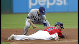 Cleveland Indians' Jordan Luplow, right, steals second base as Tampa Bay Rays' Brandon Lowe is late with the tag during the second inning of a baseball game Friday, May 24, 2019, in Cleveland. (AP Photo/Tony Dejak)