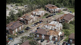 In this aerial photograph, tornado damage is seen Thursday, May 23, 2019, in Jefferson City, Mo. The National Weather Service has confirmed a large and destructive tornado touched down overnight in Missouri's state capital, causing heavy damage. (AP Photo/Jeff Roberson)