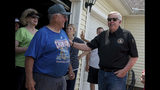 Missouri Gov. Mike Parson talks with homeowner Clyde VanWey during a visit to the Briarbrook neighborhood of Carl Junction, Mo., on Thursday May 23, 2019. A tornado damaged the area on Wednesday evening, but no fatalities were reported. (Roger Nomer/The Joplin Globe via AP)