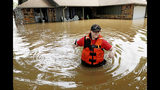Tulsa County Sheriff's Deputy Miranda Munson makes her way back to a fan boat after checking a flooded house for occupants in the Town and Country neighborhood in Sand Springs, Okla., Thursday, May 23, 2019. (Mike Simons/Tulsa World via AP)