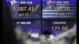 A currency trader walks near the screens showing the foreign exchange rates at the foreign exchange dealing room in Seoul, South Korea, Friday, May 24, 2019. Asian shares were mostly lower on Friday as worries that the standoff between the U.S. and China over trade might expand put investors in a selling mood. (AP Photo/Lee Jin-man)