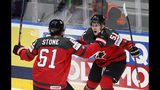 Canada's Mark Stone celebrates with Troy Stecher, right, after scoring his side's first goal during the Ice Hockey World Championships semifinal match between Canada and Czech Republic at the Ondrej Nepela Arena in Bratislava, Slovakia, Saturday, May 25, 2019. (AP Photo/Petr David Josek)