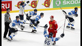 Russia's Nikita Gusev skates past Players of Finland celebrating after the Ice Hockey World Championships semifinal match between Russia and Finland at the Ondrej Nepela Arena in Bratislava, Slovakia, Saturday, May 25, 2019. (AP Photo/Petr David Josek)
