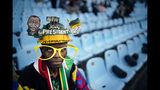 African National Congress party (ANC) supporters gather for the swearing-in ceremony for South African President Cyril Ramaphosa at Loftus Versfeld stadium in Pretoria, South Africa, Saturday, May 25, 2019. Ramaphosa has vowed to crack down on the corruption that contributed to the ruling ANC' s weakest election showing in a quarter-century. (AP Photo/Jerome Delay)
