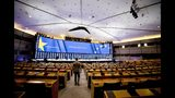 A man walks in the European Parliament as it is being set up for election night in Brussels, Friday, May 24, 2019. Some 400 million Europeans from 28 countries will head to the polls May 23-26 to choose lawmakers to represent them at the European Parliament for the next five years. (AP Photo/Virginia Mayo)