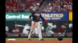 Atlanta Braves' Ozzie Albies smiles after hitting an RBI-double during the seventh inning of a baseball game against the St. Louis Cardinals, Saturday, May 25, 2019, in St. Louis. (AP Photo/Jeff Roberson)