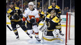 FILE - In this Feb. 13, 2018, file photo, Boston Bruins' David Krejci , left, of the Czech Republic, and goaltender Tuukka Rask, right, of Finland, defend against the Calgary Flames' Mark Jankowski during the first period of an NHL hockey game in Boston. The two Bruins veterans, who hoisted the Stanley Cup after winning it all in 2011, are among the core Bruins who will host the St. Louis Blues Monday, May 27, 2019, in Game 1 of the Stanley Cup Final.(AP Photo/Michael Dwyer)