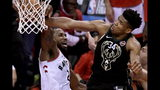 Milwaukee Bucks forward Giannis Antetokounmpo (34) blocks a dunk attempt by Toronto Raptors forward Kawhi Leonard (2) during the second half of Game 6 of the NBA basketball playoffs Eastern Conference finals Saturday, May 25, 2019, in Toronto. (Frank Gunn/The Canadian Press via AP)