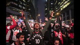 Toronto Raptors fans react as they watch Game 6 of the NBA basketball Eastern Conference finals between the Toronto Raptors and Milwaukee Bucks, on a screen outside Scotiabank Arena, in Toronto on Saturday, May 25, 2019. (Chris Young/The Canadian Press via AP)