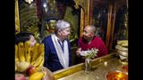 In this photo taken May 23, 2019, and released by the U.S. Embassy in Beijing, U.S. Ambassador to China Terry Branstad, left, speaks with a monk at the Jokhang Temple in Lhasa in western China's Tibet Autonomous Region. The U.S. ambassador to China urged Beijing to engage in substantive dialogue with exiled Tibetan Buddhist leader the Dalai Lama during a visit to the Himalayan region over the past week, the Embassy said Saturday. (U.S. Mission to China via AP)