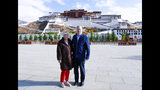 In this photo taken May 22, 2019, and released by the U.S. Embassy in Beijing, U.S. Ambassador to China Terry Branstad and his wife Christine pose for a photo in front of the Potala Palace in Lhasa in western China's Tibet Autonomous Region. The U.S. ambassador to China urged Beijing to engage in substantive dialogue with exiled Tibetan Buddhist leader the Dalai Lama during a visit to the Himalayan region over the past week, the Embassy said Saturday. (U.S. Mission to China via AP)