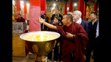 In this photo taken May 22, 2019, and released by the U.S. Embassy in Beijing, U.S. Ambassador to China Terry Branstad, second from right, visits the Sera Monastery in Lhasa in western China's Tibet Autonomous Region. The U.S. ambassador to China made a rare visit to Tibet this week to meet local officials and raise concerns about restrictions on Buddhist practices and the preservation of the Himalayan region's unique culture and language. (U.S. Mission to China via AP)