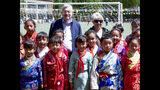 In this photo taken May 22, 2019, and released by the U.S. Embassy in Beijing, U.S. Ambassador to China Terry Branstad and his wife Christine pose for a group photo with schoolchildren as he visits an elementary school in Lhasa in western China's Tibet Autonomous Region. The U.S. ambassador to China made a rare visit to Tibet this week to meet local officials and raise concerns about restrictions on Buddhist practices and the preservation of the Himalayan region's unique culture and language. (U.S. Mission to China via AP)