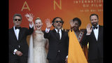 Jury members Paweł Pawlikowski, from left, Elle Fanning, jury president Alejandro Gonzalez Inarritu, jury members Maimouna N'Diaye and Yorgos Lanthimos pose for photographers upon arrival at the awards ceremony of the 72nd international film festival, Cannes, southern France, Saturday, May 25, 2019. (AP Photo/Petros Giannakouris)