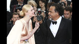 Jury member Elle Fanning, left, and jury president Alejandro Gonzalez Inarritu pose for photographers upon arrival at the opening ceremony and the premiere of the film 'The Dead Don't Die' at the 72nd international film festival, Cannes, southern France, Tuesday, May 14, 2019. (Photo by Joel C Ryan/Invision/AP)