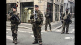 """Soldiers of French antiterrorist plan """"Vigipirate Mission"""", secure the access near the site of a suspected bomb attack in central Lyon, Friday May, 24, 2019. A small explosion Friday on a busy street in the French city of Lyon lightly injured several people, local officials said. (AP Photo/Sebastien Erome)"""
